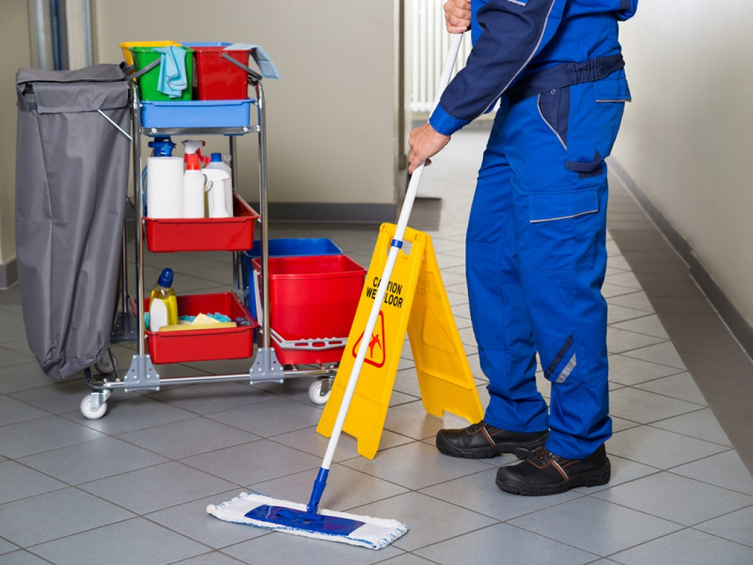 bigstock-Janitor-With-Broom-Cleaning-Of-113497175